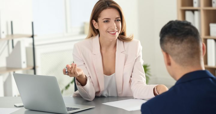 Human resources manager conducting job interview with applicant in office